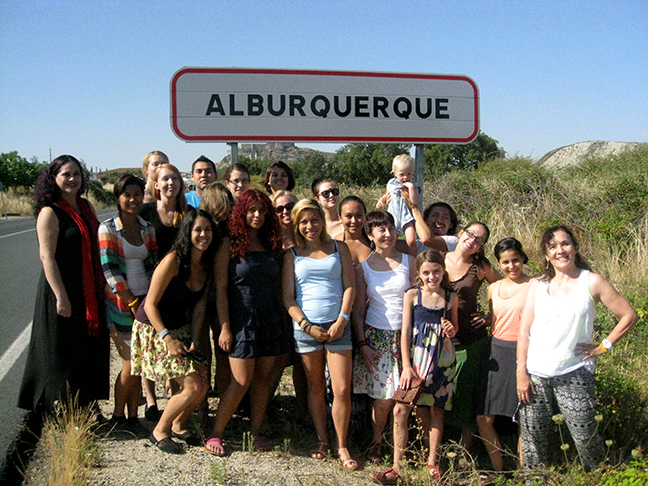 student group in front of road sign abq spain road sign
